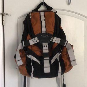 Oakley backpack orange and black —in great shape!